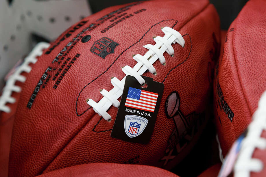 Official game balls for the NFL football Super Bowl XLVII after being laced but not formed at Wilson Sporting Goods Co. in Ada, Ohio, Monday, Jan. 21, 2013. The San Francisco Forty Niners will play the Baltimore Ravens in the Super Bowl on Feb. 3 in New Orleans. (AP Photo/Rick Osentoski) Photo: Rick Osentoski, ASSOCIATED PRESS / AP2013