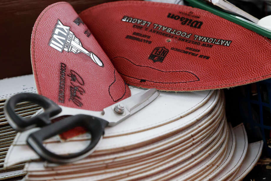 The official Super Bowl XLVII game balls wait to be  sewn together at Wilson Sporting Goods Co. in Ada, Ohio, Monday, Jan. 21, 2013. The San Francisco Forty Niners will play the Baltimore Ravens in the Super Bowl on Feb. 3 in New Orleans. (AP Photo/Rick Osentoski) Photo: Rick Osentoski, ASSOCIATED PRESS / AP2013
