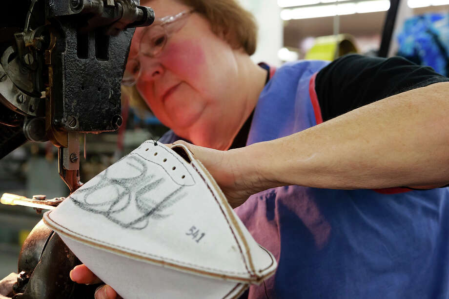 Jane Helser sews an official game ball for the NFL football Super Bowl XLVII at Wilson Sporting Goods Co. in Ada, Ohio, Monday, Jan. 21, 2013. The San Francisco Forty Niners will play the Baltimore Ravens in the Super Bowl on Feb. 3 in New Orleans. (AP Photo/Rick Osentoski) Photo: Rick Osentoski, ASSOCIATED PRESS / AP2013