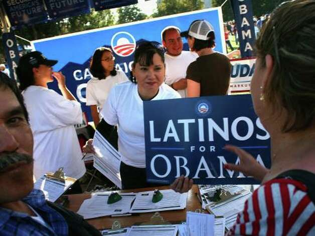 Democratic Party workers hand out signs at a celebration marking Mexican Independence Day September 14, 2008 in Denver, Colorado. The Democratic Party is working hard to register Latino voters in Colorado, which will be an important swing state in November's presidential election.