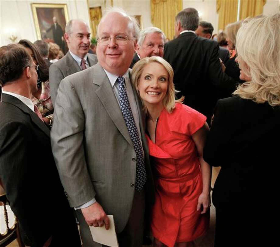 Former White House advisor Karl Rove, left, and former White House press secretary Dana Perino, right, are seen leaving the East Room of the White House in Washington, Thursday, May 31, 2012, after attending the portrait unveiling ceremony for former President George W. Bush. Photo: Pablo Martinez Monsivais, AP / AP