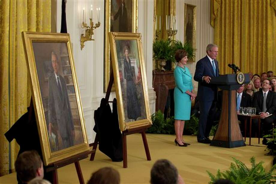 Former President George W. Bush and former first lady Laura Bush stand on stage in the East Room of the White House in Washington, Thursday, May 31, 2012, during the unveiling ceremony of their portraits. Photo: Carolyn Kaster, AP / AP