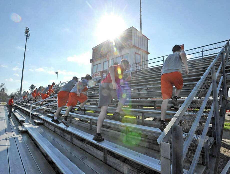 Group one hits the bleachers after the whistle is blown. Off season football workouts are going on all over the Golden Triangle. On Wednesday afternoon, January 23, 2013, the Orangefield football players got in a 45 minute spring workout during a physical education period.  They climbed stadium bleachers, they flipped truck tires, they ran circuits in the weight room, and then finished up by running a lap around the football stadium.    Dave Ryan/The Enterprise Photo: Dave Ryan