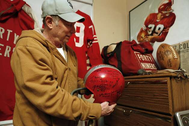 Martin Jacobs shows a signed 49ers helmet in his home on Thursday, January 24, 2013. Jacobs has been collecting 49ers memorabilia since he was a kid watching games at Kezar Stadium. Now, the retired San Francisco resident has what might be the biggest 49ers memorabilia collection in the world and keeps some of it in his San Francisco, Calif., home. Photo: Carlos Avila Gonzalez, The Chronicle