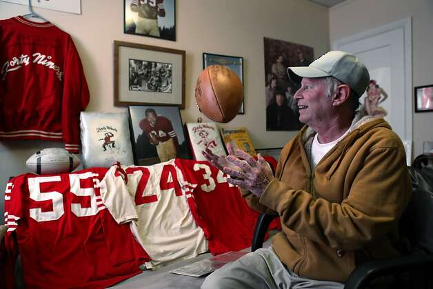 Martin Jacobs with some of his 49ers memoribilia in his home on Thursday, January 24, 2013. Jacobs has been collecting 49ers memorabilia since he was a kid watching games at Kezar Stadium. Now, the retired San Francisco resident has what might be the biggest 49ers memorabilia collection in the world and keeps some of it in his San Francisco, Calif., home. Photo: Carlos Avila Gonzalez, The Chronicle