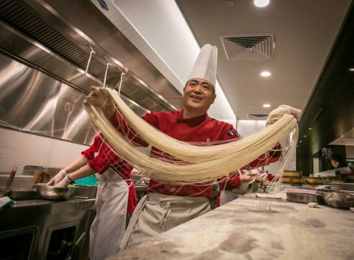 Expert noodle pullers come into the audience - uh, dining room - and perform by pulling, twisting and tossing the dough.