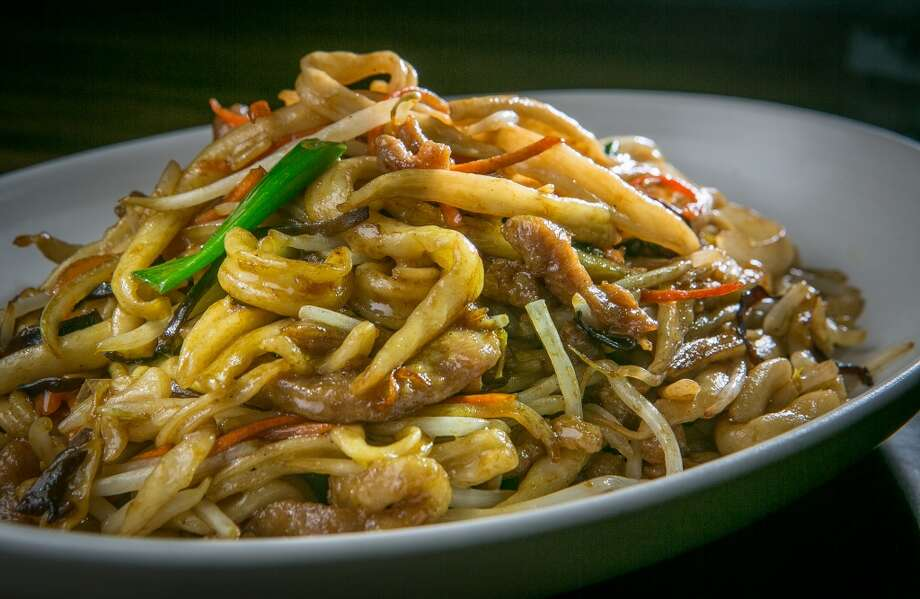 My favorite is the wild boar scissor-cut noodles ($14), thicker in the middle and pointed on the ends, with an enticing doughy texture I associate with Shanghai noodles. These are lightly coated in a meaty sauce with wine, shallots and chunks of wild boar.