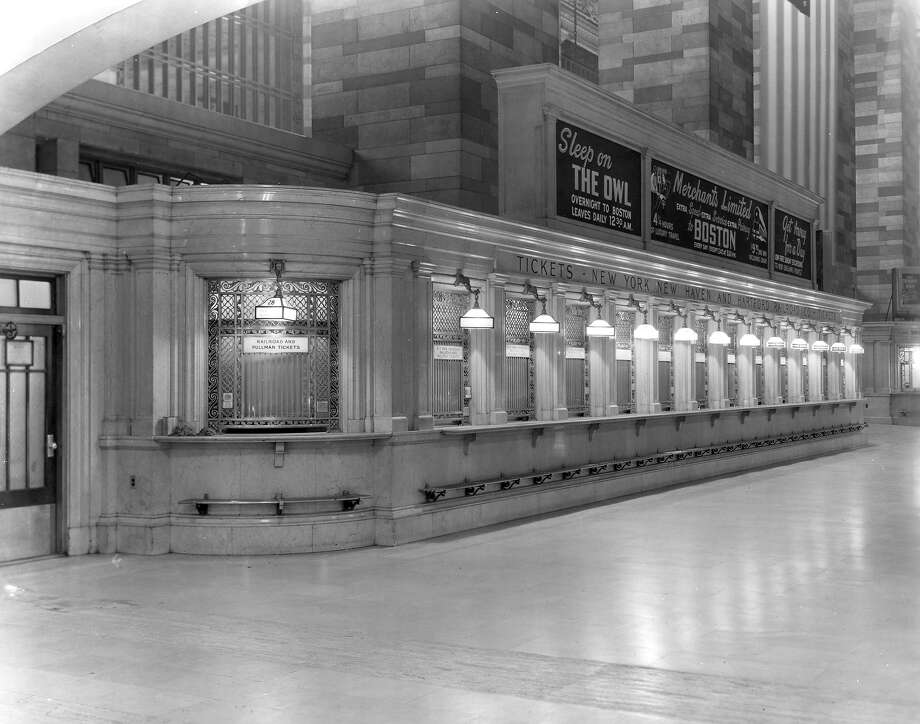 Grand  Central Terminal, ticket windows with original grills, rails and light fixtures. Photo: Anonymous, ASSOCIATED PRESS