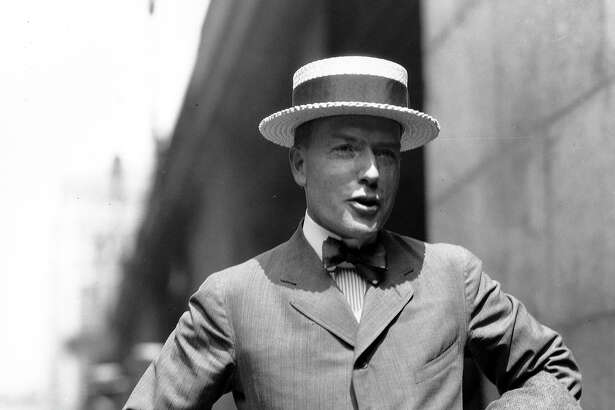 John D. Rockefeller Jr., is pictured outside Grand Central Station in New York as he left for a trip to China in Aug. 11, 1921. (AP Photo)