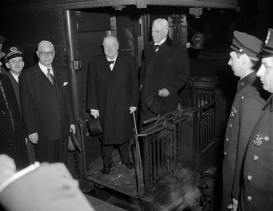 Bernard Baruch, right, stands on train platform with Prime Minister Winston Churchill of Britain as Baruch bid his old friend and guest goodbye at Grand Central Terminal in New York in 1952. Photo: Anonymous, AP / 1952 AP