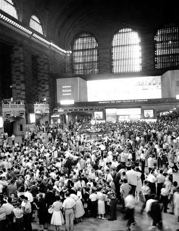 Families crowd the concourse at Grand Central Terminal as young people depart for summer camps in the New England area from New York City on June 30, 1957. Photo: AP / 1957 AP