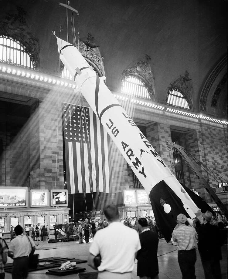 A 63-foot Redstone missile is hoisted into position for display in New York's Grand Central Terminal in 1957. To this day, there is a hole in the ceiling near a gold-leaf depiction of the constellation of Pisces that marks the spot where cables secured the rocket ship for display.  Photo: HANS VON NOLDE, ASSOCIATED PRESS / AP1957