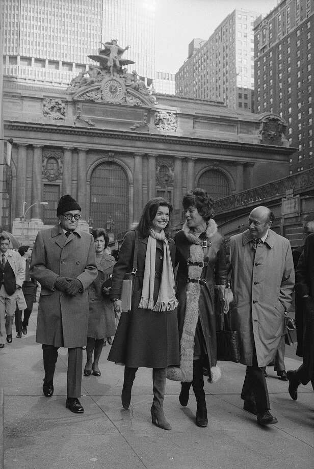 "Jackie Kennedy Onassis and Bess Myerson, former consumer advocate for New York City are flanked by architect Philip Johnson, left and U.S. Congressman, from New York, Ed Koch as they leave New York's Grand Central Terminal  after holding a news conference for the ""Committee to Save Grand Central Station"" which was trying to prevent the construction of an office tower over the city's landmark train station. Photo: Harry Harris, ASSOCIATED PRESS / AP1975"