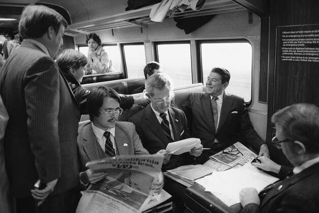 Bonzo's on-screen co-star, Ronald Reagan, shakes hands with a commuter aboard a train from Connecticut to Grand Central in 1980. Photo: Ron Frehm, ASSOCIATED PRESS / AP1980