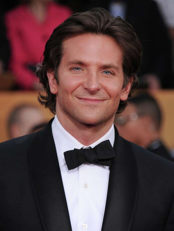 Actor Bradley Cooper arrives at the 19th Annual Screen Actors Guild Awards at the Shrine Auditorium in Los Angeles on Sunday, Jan. 27, 2013. (Photo by Jordan Strauss/Invision/AP) Photo: Jordan Strauss, Associated Press / Invision