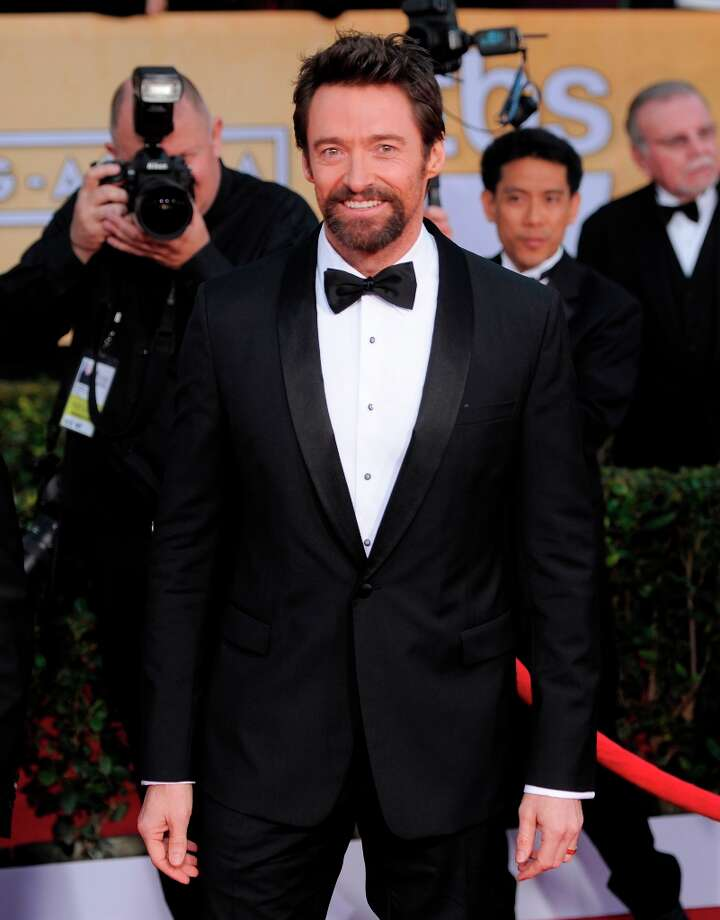 Hugh Jackman arrives at the 19th Annual Screen Actors Guild Awards at the Shrine Auditorium in Los Angeles on Sunday Jan. 27, 2013. (Photo by Chris Pizzello/Invision/AP) Photo: Chris Pizzello, Associated Press / Invision
