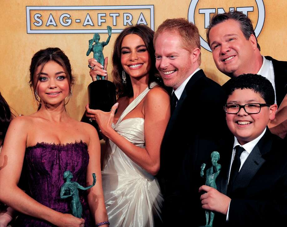 The cast of Modern Family poses backstage with the award for ensemble in a comedy series at the 19th Annual Screen Actors Guild Awards at the Shrine Auditorium in Los Angeles on Sunday Jan. 27, 2013. (Photo by Chris Pizzello/Invision/AP) Photo: Chris Pizzello, Associated Press / Invision