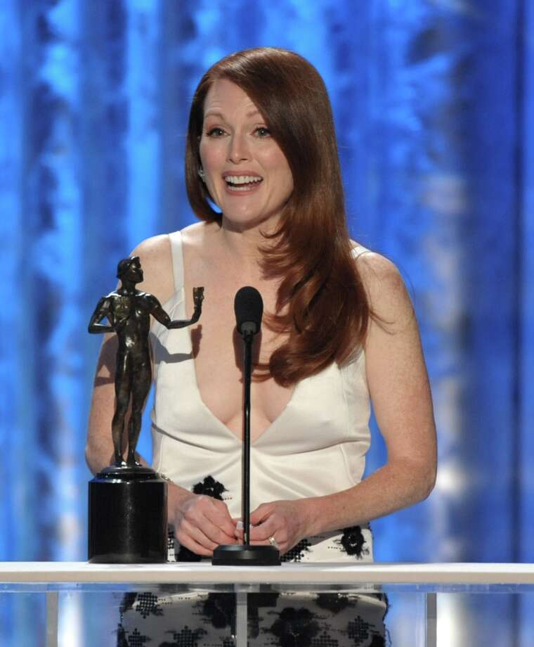 "Julianne Moore accepts the award for outstanding female actor in a TV movie or miniseries for ""Game Change"" at the 19th Annual Screen Actors Guild Awards at the Shrine Auditorium in Los Angeles on Sunday, Jan. 27, 2013. (Photo by John Shearer/Invision/AP) Photo: John Shearer, Associated Press / Invision"