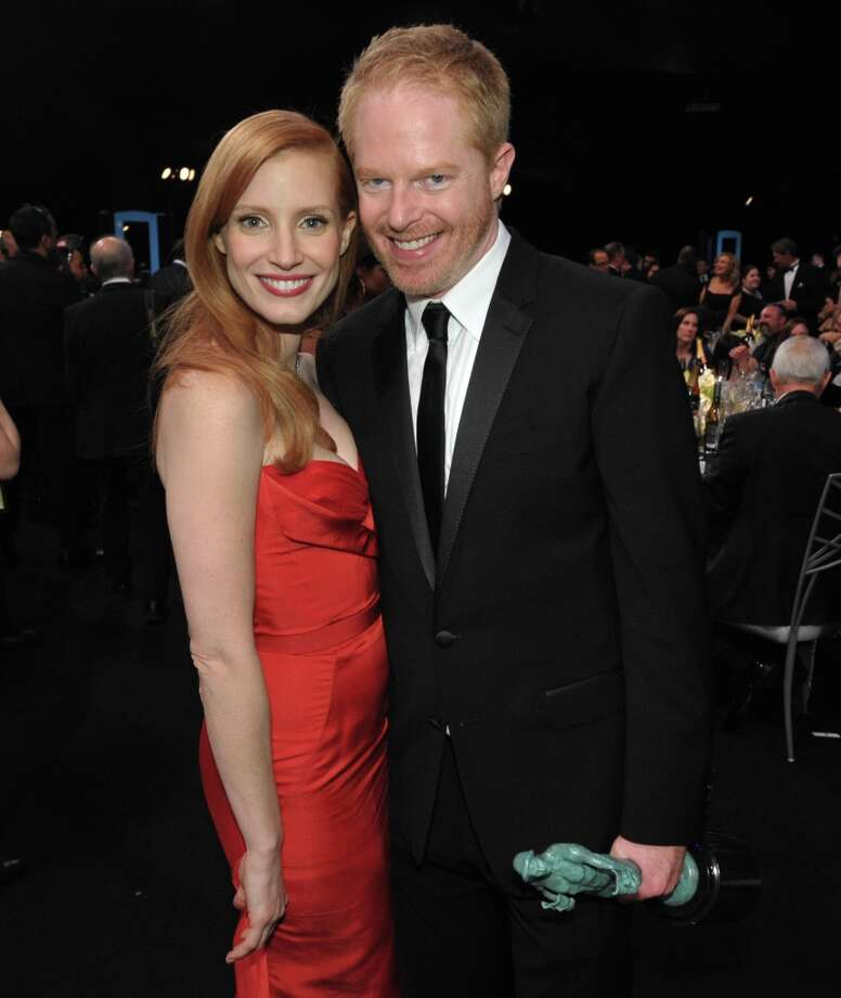 Jessica Chastain, left, and Jesse Tyler Ferguson pose in the audience at the 19th Annual Screen Actors Guild Awards at the Shrine Auditorium in Los Angeles on Sunday Jan. 27, 2013. (Photo by John Shearer/Invision/AP) Photo: John Shearer, Associated Press / Invision