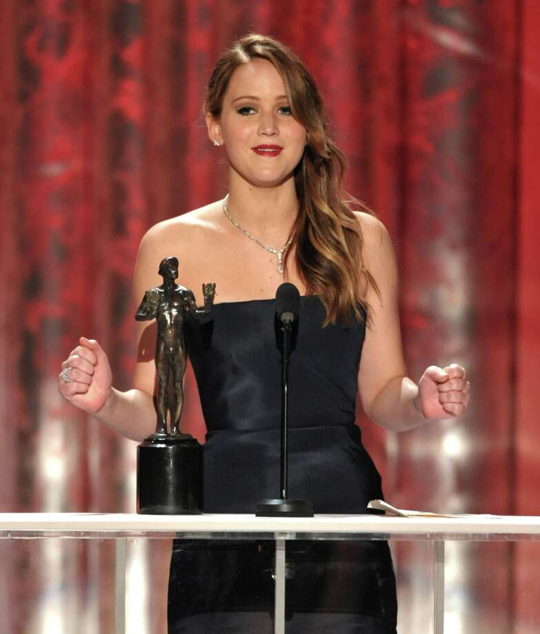 "Jennifer Lawrence accepts the award for outstanding female actor in a leading role for ""Silver Linings Playbook"" at the 19th Annual Screen Actors Guild Awards at the Shrine Auditorium in Los Angeles on Sunday Jan. 27, 2013. (Photo by John Shearer/Invision/AP) Photo: John Shearer, Associated Press / Invision"