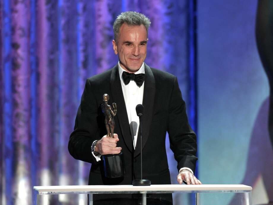 "Daniel Day-Lewis accepts the awards for outstanding male actor in a leading role for ""Lincoln"" at the 19th Annual Screen Actors Guild Awards at the Shrine Auditorium in Los Angeles on Sunday Jan. 27, 2013. (Photo by John Shearer/Invision/AP) Photo: John Shearer, Associated Press / Invision"