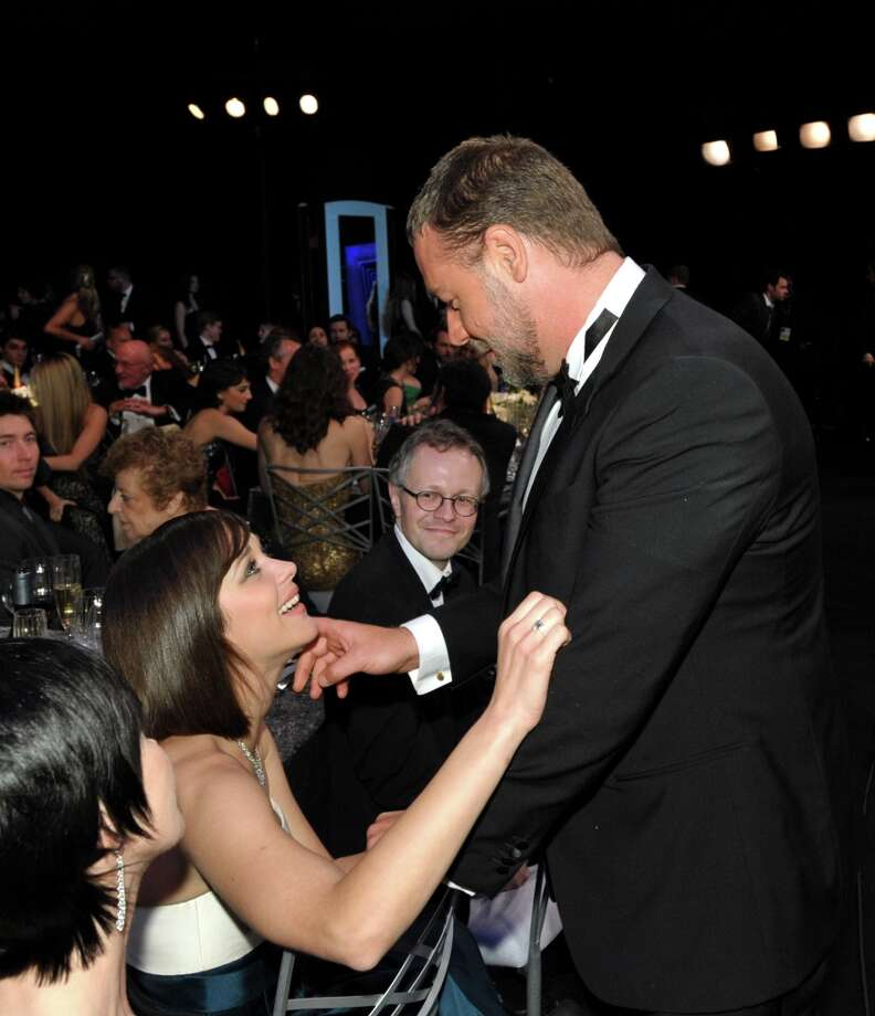 Actress Marion Cotillard, left, and Russell Crowe speak in the audience at the 19th Annual Screen Actors Guild Awards at the Shrine Auditorium in Los Angeles on Sunday Jan. 27, 2013. (Photo by John Shearer/Invision/AP) Photo: John Shearer, Associated Press / Invision