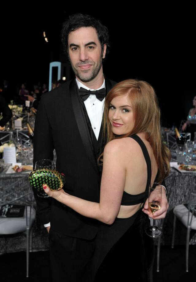 Sacha Baron Cohen, left, and Isla Fisher pose in the audience at the 19th Annual Screen Actors Guild Awards at the Shrine Auditorium in Los Angeles on Sunday Jan. 27, 2013. (Photo by John Shearer/Invision/AP) Photo: John Shearer, Associated Press / Invision