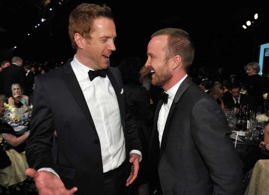 Damian Lewis, left, and Aaron Paul talk together in the audience at the 19th Annual Screen Actors Guild Awards at the Shrine Auditorium in Los Angeles on Sunday Jan. 27, 2013. (Photo by John Shearer/Invision/AP) Photo: John Shearer, Associated Press / Invision