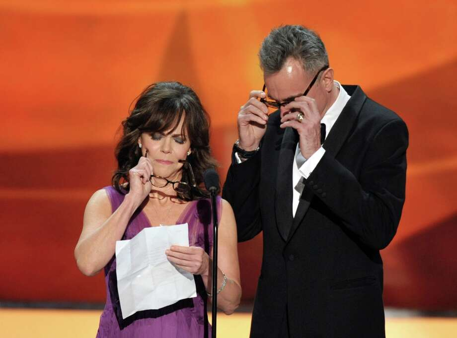 Sally Field, left, and Daniel Day-Lewis put on their glasses onstage at the 19th Annual Screen Actors Guild Awards at the Shrine Auditorium in Los Angeles on Sunday Jan. 27, 2013. (Photo by John Shearer/Invision/AP) Photo: John Shearer, Associated Press / Invision