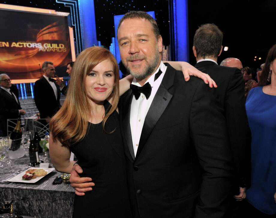 Isla Fisher, left, and Russell Crowe pose in the audience at the 19th Annual Screen Actors Guild Awards at the Shrine Auditorium in Los Angeles on Sunday Jan. 27, 2013. (Photo by John Shearer/Invision/AP) Photo: John Shearer, Associated Press / Invision