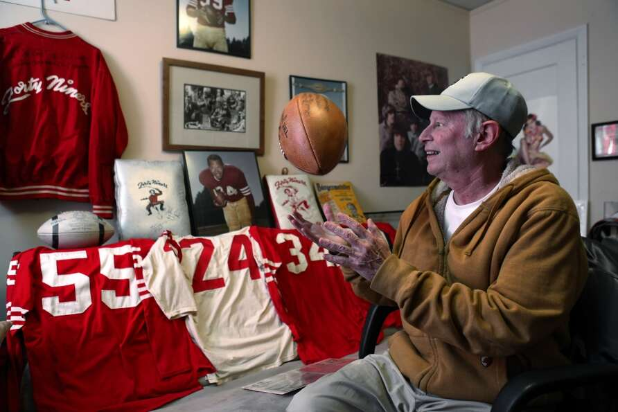 Martin Jacobs with some of his 49ers memoribilia in his home on Thursday, January 24, 2013. Jacobs h