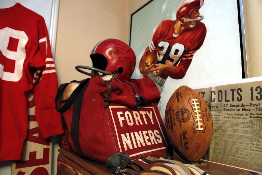 Several items of memoribilia in Martin Jacobs's home on Thursday, January 24, 2013, include leather chin straps, game balls, jersies, and equipment bags. Jacobs has been collecting 49ers memorabilia since he was a kid watching games at Kezar Stadium. Now, the retired San Francisco resident has what might be the biggest 49ers memorabilia collection in the world and keeps some of it in his San Francisco, Calif., home. Photo: Carlos Avila Gonzalez, The Chronicle / ONLINE_YES