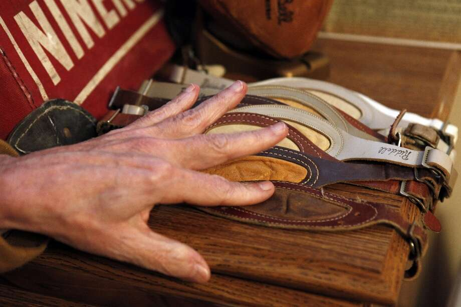 Several items of memoribilia in Martin Jacobs's home on Thursday, January 24, 2013, include leather chin straps, game balls and equipment bags. Jacobs has been collecting 49ers memorabilia since he was a kid watching games at Kezar Stadium. Now, the retired San Francisco resident has what might be the biggest 49ers memorabilia collection in the world and keeps some of it in his San Francisco, Calif., home. Photo: Carlos Avila Gonzalez, The Chronicle / ONLINE_YES