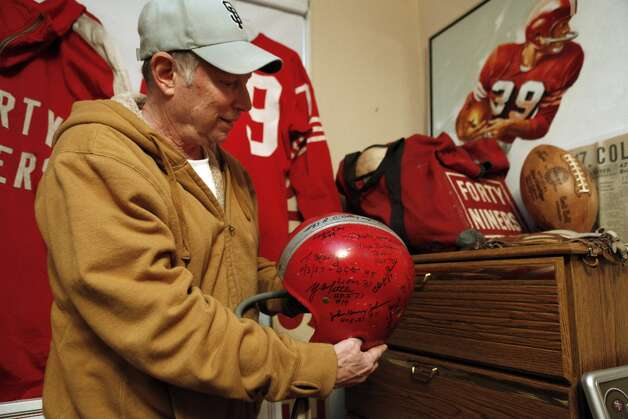 Martin Jacobs shows a signed 49ers helmet in his home on Thursday, January 24, 2013. Jacobs has been collecting 49ers memorabilia since he was a kid watching games at Kezar Stadium. Now, the retired San Francisco resident has what might be the biggest 49ers memorabilia collection in the world and keeps some of it in his San Francisco, Calif., home. Photo: Carlos Avila Gonzalez, The Chronicle / ONLINE_YES