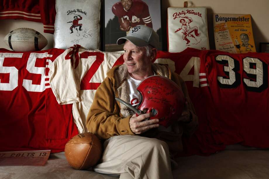 Martin Jacobs, an avid memorabilia collector, with some of his 49ers items on Thursday, January 24, 2013. Jacobs has been collecting 49ers memorabilia since he was a kid watching games at Kezar Stadium. Now, the retired San Francisco resident has what might be the biggest 49ers memorabilia collection in the world and keeps some of it in his San Francisco, Calif., home. Photo: Carlos Avila Gonzalez, The Chronicle / ONLINE_YES