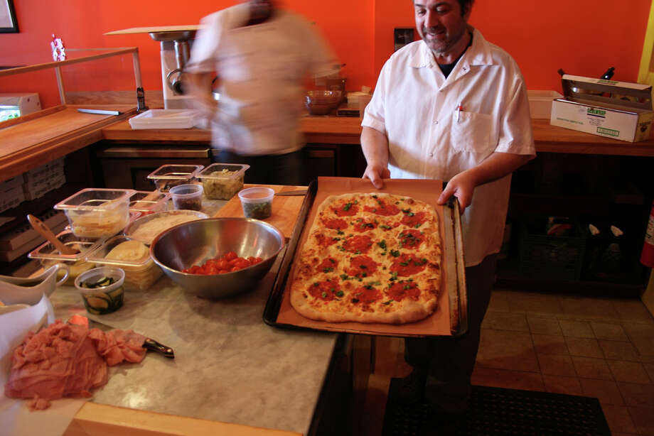Romanacci  will feature items such as Panini sandwiches, crepes, a coffee/espresso bar, wine and artisan cheeses, and pizzas made from organic Italian flour and the freshest ingredients. Photo: Contributed Photo