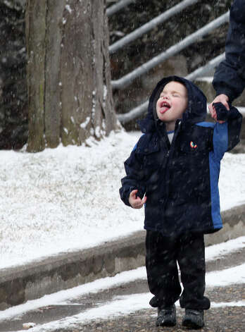 Edwards Greist, 2, catches snowflakes in Stratford, Conn, on Monday, January 28, 2012. Photo: BK Angeletti, B.K. Angeletti / Connecticut Post freelance B.K. Angeletti