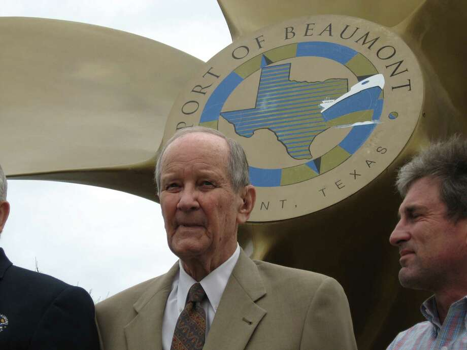 "Henry Nix, center, stands under the large-bladed ship's propeller at the Port of Beaumont for a ""class picture"" with port employees, which was planned coincidental to his announcement that he would not run for a sixth term as port commissioner from Ward 2. Nix has served on the commission since his first election in April 1983 and ran unopposed since then. Dan Wallach/The Enterprise Photo: Dan Wallach"