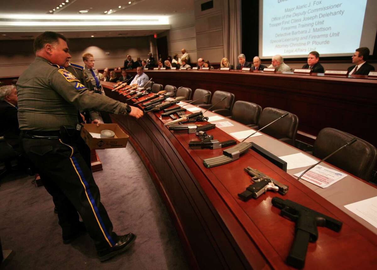 State police put out an array of firearms during testimony before the Gun Violence Prevention Working Group at the Legislative Office Building in Hartford on Monday, January 28, 2012.
