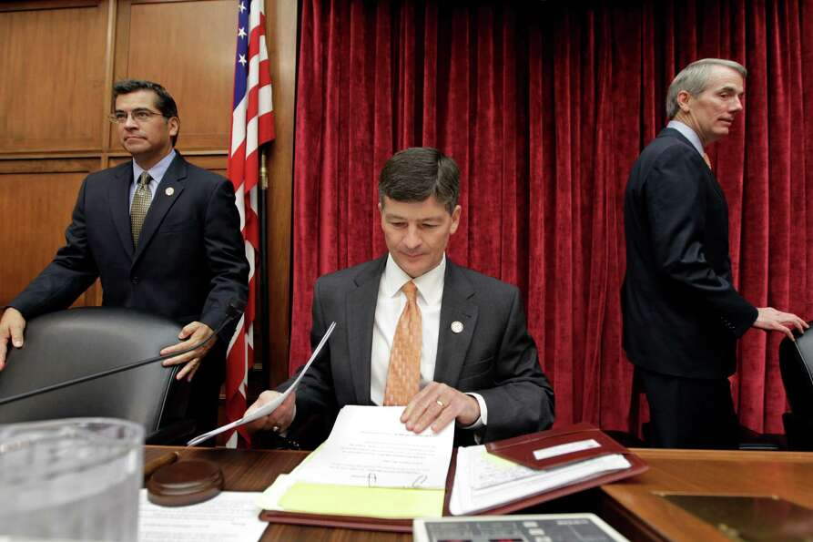 Rep. Jeb Hensarling, R-Dallas, joined by Rep. Xavier Becerra, D-Calif., left, and Sen. Rob Portman,