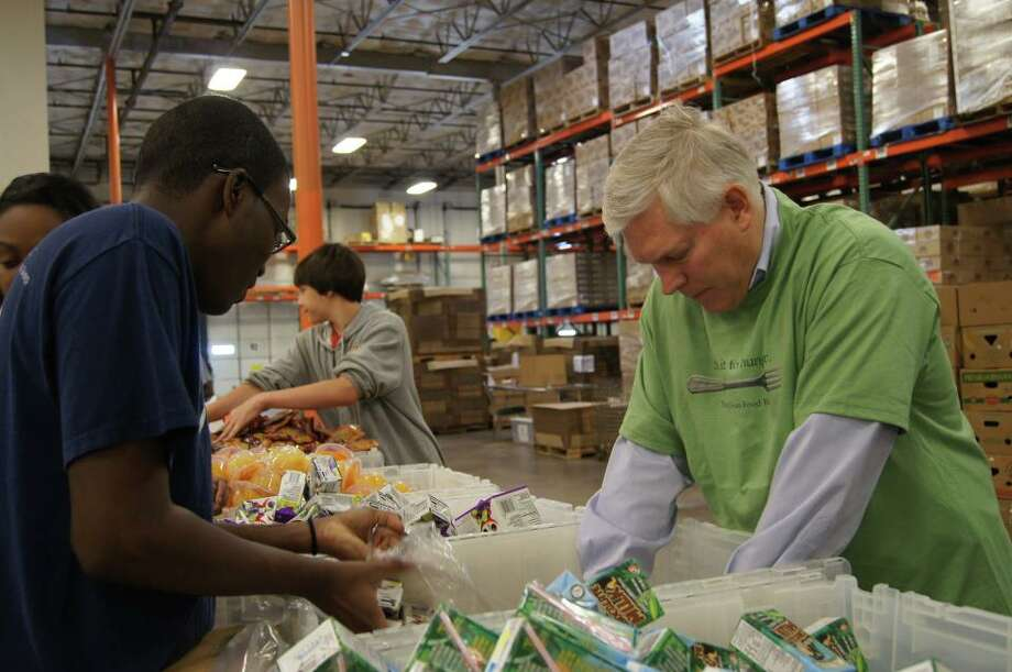 Rep. Pete Sessions helped sort and pack Senior Care Packages at the North Texas Food Bank's Cockrell Hill warehouse with his Dallas staff and local volunteers on March 15, 2012.