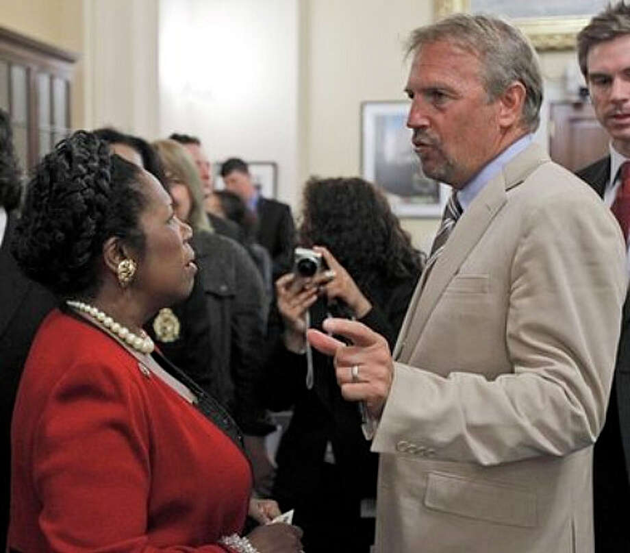 Actor Kevin Costner, right, talks with House Homeland Security Committee member Rep. Sheila Jackson Lee, D-Texas,  on Capitol Hill in Washington Wednesday, Sept. 22, 2010, after he testified before the committee's hearing on the lessons from the Deepwater Horizon oil spill, Hill. Photo: AP
