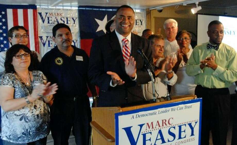 U.S. House of Representatives District 33 candidate, Marc Veasey, applauds his supporters during an election day celebration at Smokeys BBQ on Lancaster Avenue in East Fort Worth Tuesday, May 29, 2012 evening.