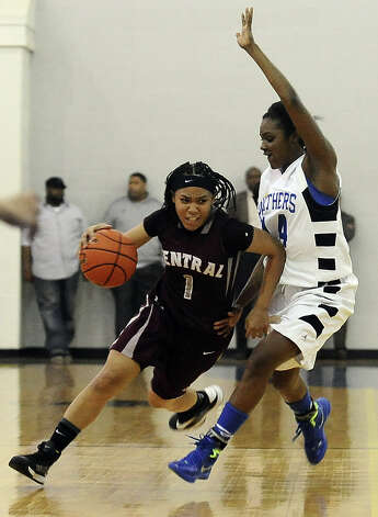 Central Lady Jaguar Malena Washington, #1, charges down the court during the Ozen High School girls basketball game against Central High School on Tuesday, January 22, 2013, at Ozen High School.  Ozen won 63 - 53. Photo taken: Randy Edwards/The Enterprise Photo: Randy Edwards