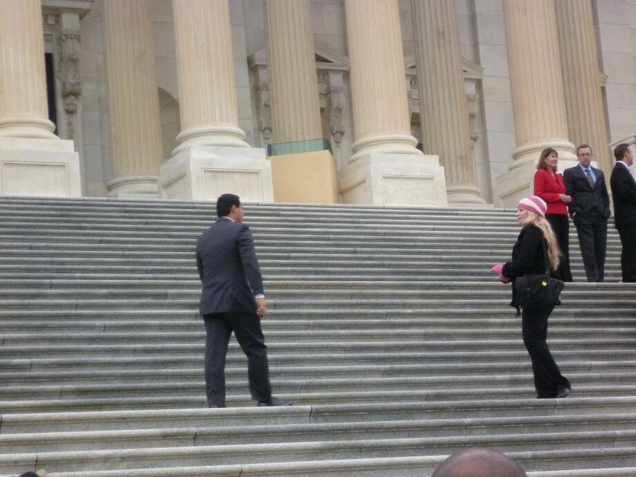Joaquin Castro walking up the steps of the Capitol.