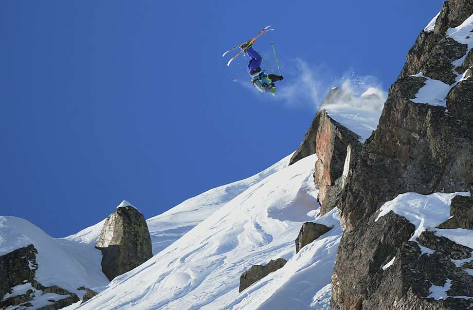"Shredding the Needle: Stefan Hausl of Austria somersaults off a ledge of ""l'Aiguille Pourrie,"" which translates as ""Rotten Needle,"" during the French stage of the Freeride World Tour in Chamonix, French Alps. Photo: Philippe Desmazes, AFP/Getty Images"