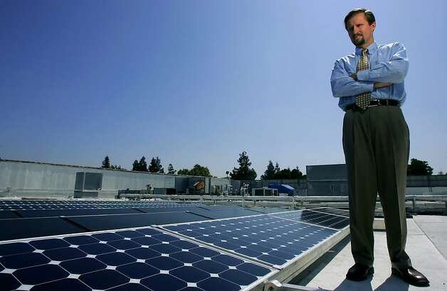 ** ADVANCE MONDAY SEPT 18 ** SunPower Corp. CEO Thomas Werner is photographed next to the solar panels on the roof of the SunPower building in San Jose, Aug. 24, 2006. Silicon Valley is leveraging its expertise in computer chips to design and manufacture the solar cells needed to convert sunlight into electricity. As prices for fossil fuels rise and demand for renewable energy grows, the region known for its silicon-based semiconductors is emerging as a key center for solar power technology.  (AP Photo/Jeff Chiu)  Ran on: 05-22-2011 Photo caption Dummy text goes here. Dummy text goes here. Dummy text goes here. Dummy text goes here. Dummy text goes here. Dummy text goes here. Dummy text goes here. Dummy text goes here.###Photo: insight22_kazakoff_PH41156291200AP###Live Caption:###Caption History:** ADVANCE MONDAY SEPT 18 ** SunPower Corp. CEO Thomas Werner is photographed next to the solar panels on the roof of the SunPower building in San Jose, Aug. 24, 2006. Silicon Valley is leveraging its expertise in computer chips to design and manufacture the solar cells needed to convert sunlight into electricity. As prices for fossil fuels rise and demand for renewable energy grows, the region known for its silicon-based semiconductors is emerging as a key center for solar power technology.  (AP Photo-Jeff Chiu)###Notes:###Special Instructions:ADV MONDAY SEPT 18 Ran on: 05-22-2011 Photo caption Dummy text goes here. Dummy text goes here. Dummy text goes here. Dummy text goes here. Dummy text goes here. Dummy text goes here. Dummy text goes here. Dummy text goes here.###Photo: insight22_kazakoff_PH41156291200AP###Live Caption:###Caption History:** ADVANCE MONDAY SEPT 18 ** SunPower Corp. CEO Thomas Werner is photographed next to the solar panels on the roof of the SunPower building in San Jose, Aug. 24, 2006. Silicon Valle Photo: Jeff Chiu, Associated Press 2006