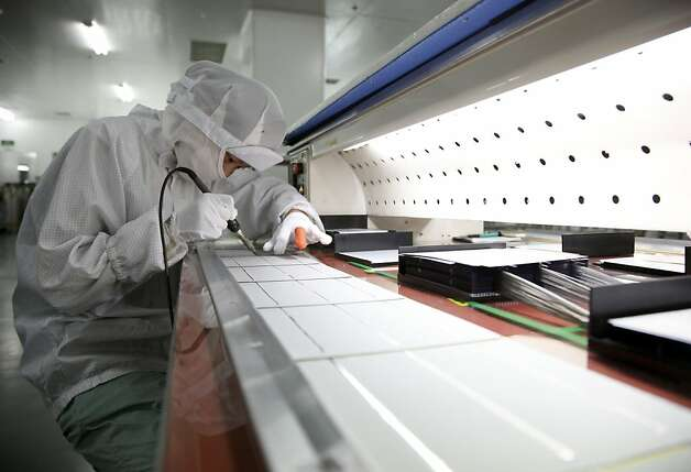 "A worker operates on the assembly line that makes photovoltaic cells, the main energy generating component of a solar panel, at the Suntech Power Holdings Co. factory in Wuxi, China, on Tuesday, July 28, 2009. Suntech Power Holdings Co. and Yingli Green Energy Holding Co. are two solar companies which stand to gain from projects China is undertaking and subsidizing, ""Mad Money's"" Jim Cramer said on his program. Photographer: Qilai Shen/Bloomberg Photo: Qilai Shen, Bloomberg"