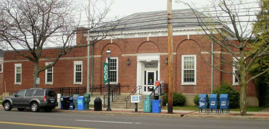 The owners of the former Post Office building on the Post Road are seeking a variance to reduce required parking spaces. Photo: File Photo / Fairfield Citizen