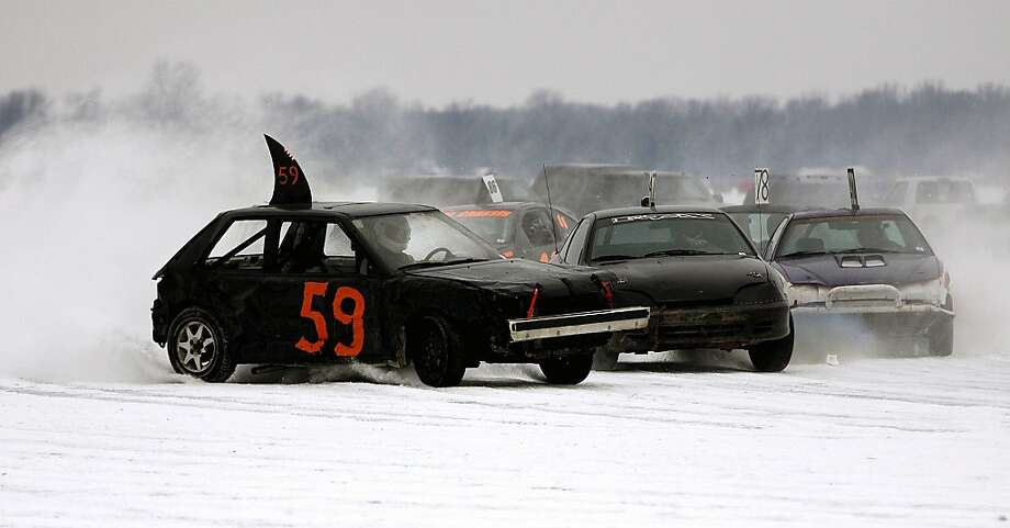 It's time we outlaw shark fin souped-up cars:They're a menace on the road or frozen lake. Just look at this guy cutting off another motorist. So rude. (Ice racing on Shawano Lake in Cecil, Wis.) Photo: Cory Dellenbach, Associated Press